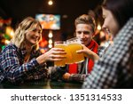 football fans drinks beer in... | Shutterstock . vector #1351314533