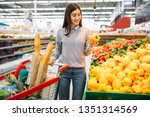 woman choosing fresh sweet... | Shutterstock . vector #1351314569