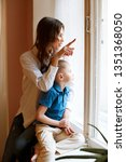 young mother with son child...   Shutterstock . vector #1351368050