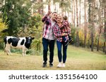 young family with little son... | Shutterstock . vector #1351564100