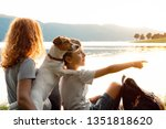 happy young woman and her son... | Shutterstock . vector #1351818620