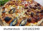homemade pizza on wooden plate   | Shutterstock . vector #1351822340