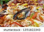 homemade pizza on wooden plate   | Shutterstock . vector #1351822343