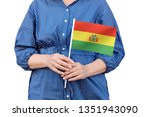 bolivia flag. close up of woman'... | Shutterstock . vector #1351943090