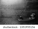 black old handset with a wire...   Shutterstock . vector #1351955156