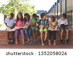 front view of diverse students... | Shutterstock . vector #1352058026