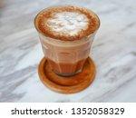 the glass of macchiato on the... | Shutterstock . vector #1352058329