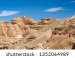 high rocky mountains in the... | Shutterstock . vector #1352064989