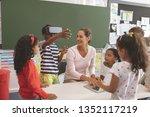 front view of schoolboy using... | Shutterstock . vector #1352117219