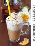 Coffee latte with whipped cream and chocolate. - stock photo