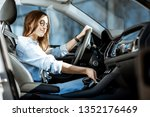 young woman taking a smart... | Shutterstock . vector #1352176469