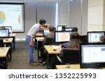 Small photo of BANGKOK, THAILAND - March 19: Computer Room Excise Department on March 19,2019 in Bangkok, Thailand. Instructor teaching how to use Graphic Design Software to Students at Computer room