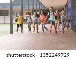 front view of happy school kids ... | Shutterstock . vector #1352249729