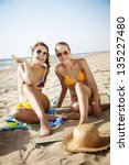 two attractive females on the... | Shutterstock . vector #135227480