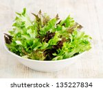 Lettuce Salad Mix On A Wooden...