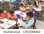 overhead view of school kids... | Shutterstock . vector #1352388863