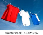 Stock photo a set of red white and blue t shirts hanging on a clothesline on a beautiful sunny day add text 13524226