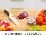 Closeup On Onion And Knife On...