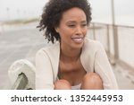 front view of happy young... | Shutterstock . vector #1352445953