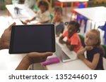 close up of a teacher holding a ... | Shutterstock . vector #1352446019