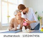 happy mother's day  adult... | Shutterstock . vector #1352447456