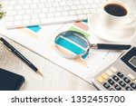 magnifier on graph on working... | Shutterstock . vector #1352455700
