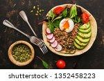 buckwheat porridge with boiled... | Shutterstock . vector #1352458223