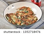 potato pancakes with spinach in ... | Shutterstock . vector #1352718476