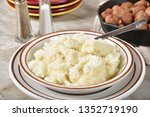 a bowl of creamy mashed... | Shutterstock . vector #1352719190