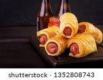 sausage in the dough on a... | Shutterstock . vector #1352808743