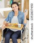 pretty woman sitting in a wheel ...   Shutterstock . vector #1352837450
