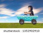 happy boy is racing in the... | Shutterstock . vector #1352902910
