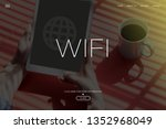 wifi and workplace concept   Shutterstock . vector #1352968049