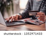 woman shopping online and using ... | Shutterstock . vector #1352971433