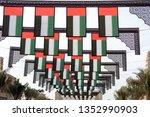 flags waving in the sky ... | Shutterstock . vector #1352990903