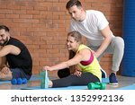 sporty young people training... | Shutterstock . vector #1352992136