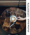 a cup of hot macchiato coffee | Shutterstock . vector #1353037376