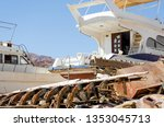 dump of old boats in egypt dahab | Shutterstock . vector #1353045713