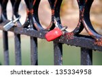 Many Locks On The Metal Fence