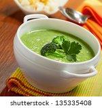 broccoli cream soup on table | Shutterstock . vector #135335408