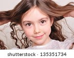 portrait of a pretty 8 year old ... | Shutterstock . vector #135351734