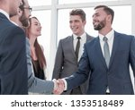 business partners at a meeting... | Shutterstock . vector #1353518489
