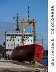 """Small photo of PARRY SOUND, ONTARIO, CANADA - MAY 1, 2012: Canadian Coast Guard Ship, """"Griffon"""" a High Endurance Multi-Tasked, Light Icebreaker Vessel, Docking at the CCG yard in Parry Sound, Ontario. Front view."""