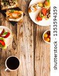 breakfast table with tasty... | Shutterstock . vector #1353594359