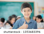 asian primary student and... | Shutterstock . vector #1353683396