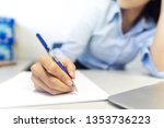 woman signing document  close...   Shutterstock . vector #1353736223