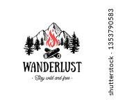 wanderlust logo with campfire.... | Shutterstock .eps vector #1353790583