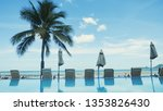 swimming pool with palm tree... | Shutterstock . vector #1353826430