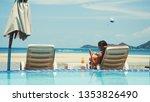 beautiful young woman using her ... | Shutterstock . vector #1353826490