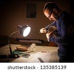 an archeologist examining some... | Shutterstock . vector #135385139